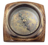 Compass on wooden base